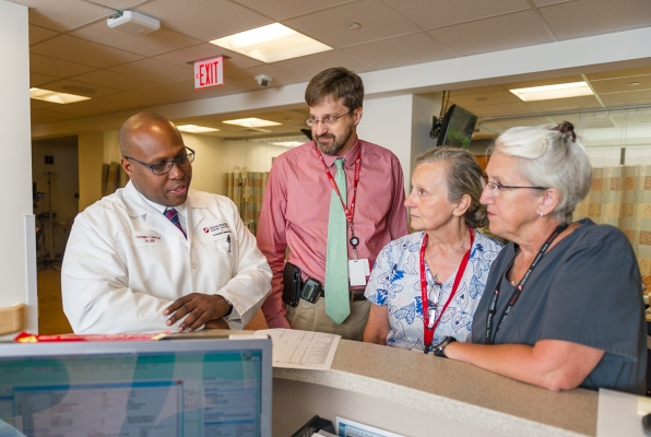 Dana-Farber clinicians discuss a patient record.